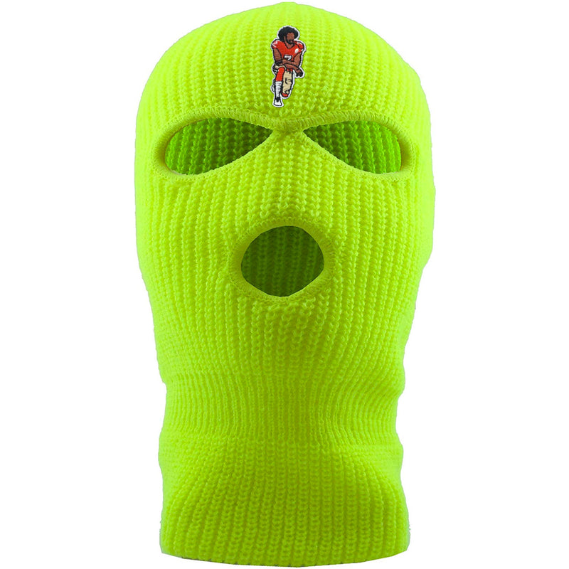 On the front of the kaepernick safety yellow ski mask is the colin kaepernick taking a knee logo