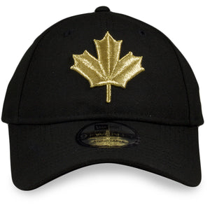 the Toronto Raptors 2019 NBA City Series Black Dad Hat | Metallic Gold Leaf Logo Raptors Baseball Cap has a shiny gold maple leaf on the front