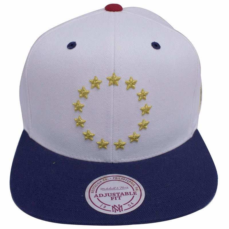 on the front of the philadelphia 76ers usa flag patch snapback hat is a gold circular star ring