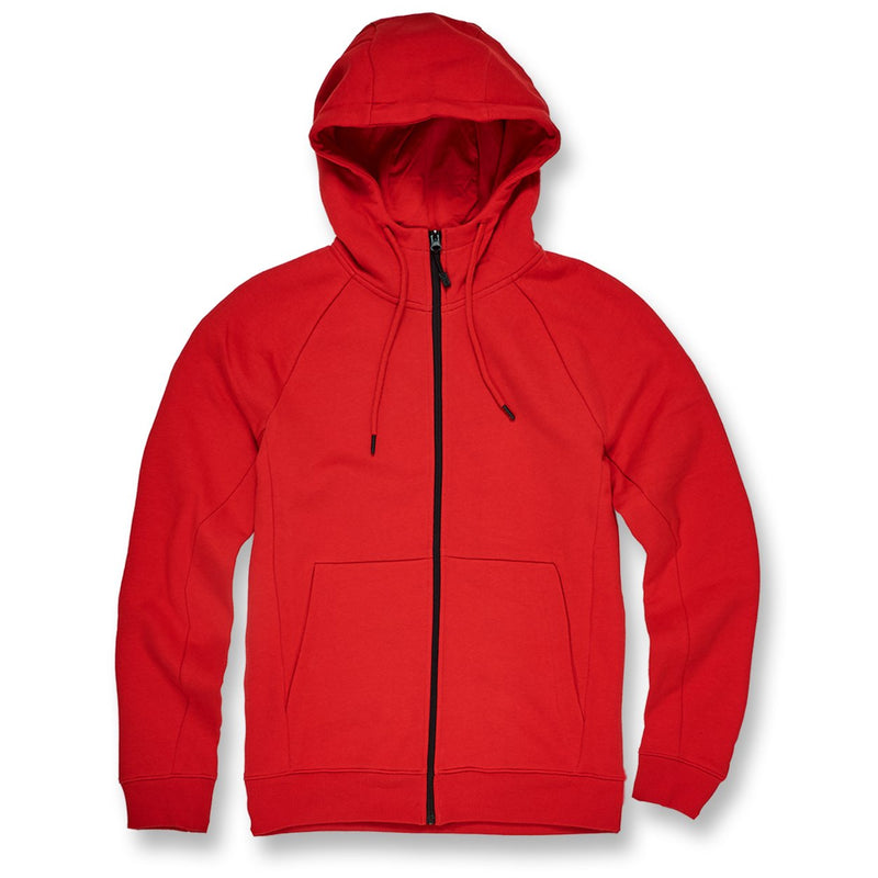 on the front of the red jordan craig fleece zip-up jacket is a black zipper