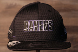 Ravens 2020 Training Camp Snapback Hat | Baltimore 2020 On-Field Black Training Camp Snap Cap the front of this ravens cap has the ravens name on the front