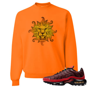 printed on the front of the air max plus sunburst sneaker matching safety orange crewneck sweatshirt is the vintage lion head logo