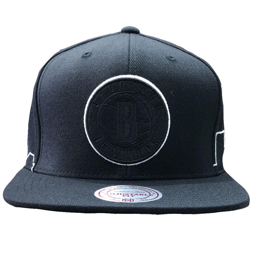 1ecdd79fae3 The brooklyn nets black city skyline mitchell and ness snapback hat  features a blacked out Brooklyn
