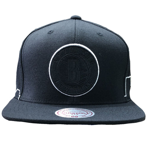 d6484e213dad5 The brooklyn nets black city skyline mitchell and ness snapback hat  features a blacked out Brooklyn