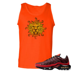 printed on the front of the air max plus sunburst sneaker matching orange tank top is the vintage lion head logo