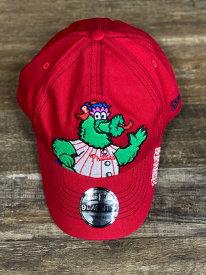 on the front of the Philadelphia Phillies Kids Fuzzy Red Philly Phanatic Character Dad Hat is a fuzzy mascot character and a label that says the baseball cap is youth size