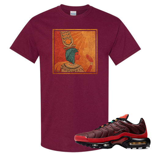 printed on the front of the air max plus sunburst sneaker matching maroon tee shirt is the vintage egyptian logo
