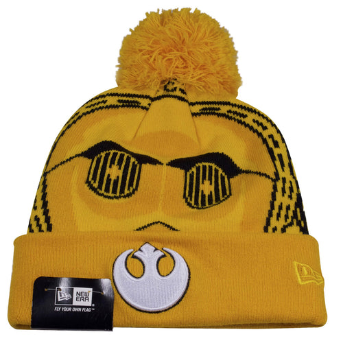 This Star Wars C-3PO winter beanie hat has the Rebel Alliance logo embroidered on the front of this cuff. The front of this golden beanie has the design works of C-3PO face on it. The top of this Star Wars beanie has a golden Pom. The New Era logo can be seen on the left side in yellow threading.