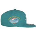 The Super Bowl Championship text can be seen on top of a football logo of Miami Dolphins on the right side of this Tribute Turn snapback hat. There is two gold stars shown on the bottom of the Dolphin logo to show that they have won two Super Bowls over the years.