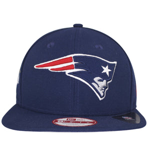 on the front of the navy blue vintage 4x super bowl champion new england patriots snapback hat is the patriots logo embroidered in navy blue, red, and white