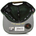 Underneath this hat shows the years of when Green Bay Packers in small gold ink