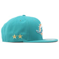 Two golden stars are shown embroidered on the right side of this New Era Dolphin snapback cap.
