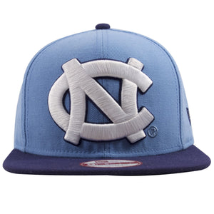 On the front of this UNC North Carolina Blue Snapback hat shows a extra large Tar Heels logo heavily embroidered in white threading.
