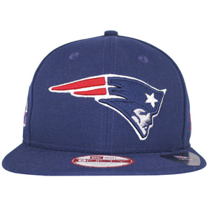 on the front of the new england patriots 4x super bowl champions throwback snapback hat is the new england patriots logo embroidered in navy blue, red, and white
