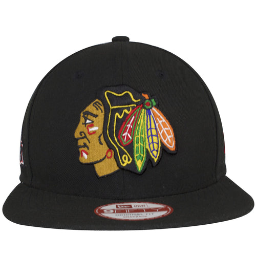on the front of the chicago blackhawks 6 time stanley cup champions snapback hat is the chicago blackhawks logo embroidered in tan, black, red, white, and green
