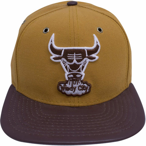 The chicago bulls wheat timberland boot inspired snapback hat is custom designed to match the wheat timbs, on the front of the Wheat Timberland Chicago Bulls snapback hat is a vintage windy city chicago bulls logo embroidered in brown and white