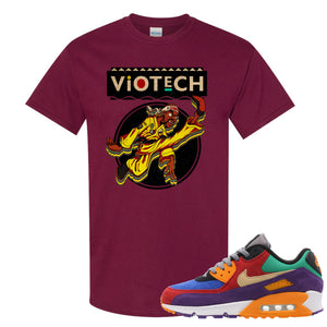 Printed on the front of the Air Max 90 Viotech maroon sneaker matching t-shirt is the Viotech Rattlesnake Jones logo