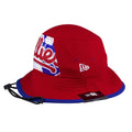 on the left side of the philadelphia phillies red bucket hat liberty bell logo is the new era logo embroidered in white