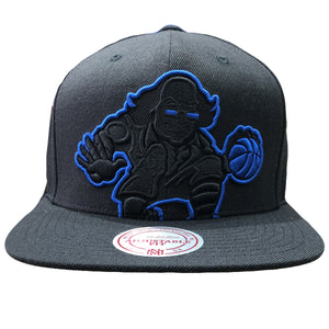 Embroidered on the front of the Philadelphia 76ers black snapback hat is the ballin ben franklin logo in black and blue