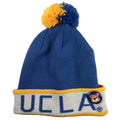 across the front of the ucla bruins mitchell and ness winter knit beanie is the word UCLA in blue with the UCLA bears pin attached