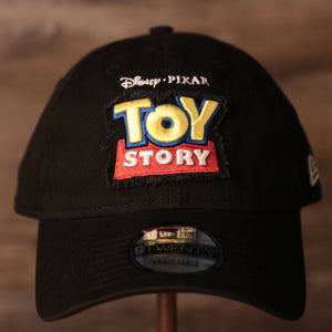 Toy Story Black Dad Hat | Toy Story Logo Black Adjustable Dad Cap the front of this cap has the toy story logo