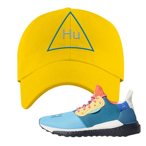 Foot Clan  Pharrel Williams X SolarHU Multicolor  HU Triangle  Yellow  Dad Hat    Match your shoes with this Pharrel Williams X SolarHU Multicolor Sneaker Yellow Dad Hat. The HU Triangle logo on the front of this Pharrel Williams X SolarHU Multicolor Sneaker Yellow Dad Hat is perfect to match these kicks. Up your match-game now!