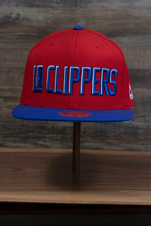 the front of the Los Angeles Clippers XL Logo Red Snapback Hat | LA Clippers Big Logo Green Bottom Snap Back has extra tall letters spelling out LA CLIPPERS