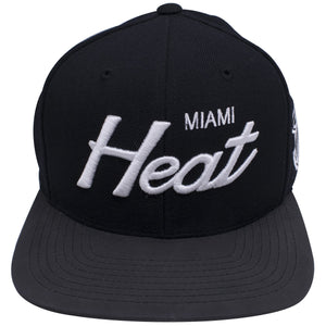 on the front of the Miami Heat script black reflective brim snapback, the Miami Heat lettering is embroidered in solid white on a black crown