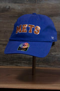 the New York Mets Sequin Lettering Blue Womens Baseball Hat | Ladies Royal Blue Mets Baseball Hat with Sequins has a sparkly orange Mets logo on the front