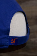 the tag on the New York Mets Sequin Lettering Blue Womens Baseball Hat | Ladies Royal Blue Mets Baseball Hat with Sequins is embroidered with the letters NY in orange