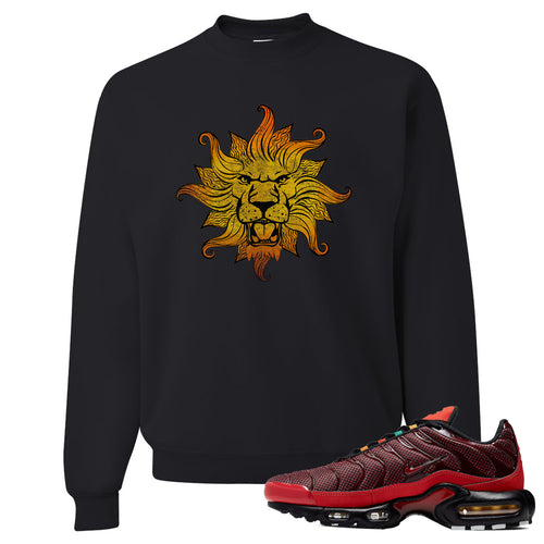 printed on the front of the air max plus sunburst sneaker matching black crewneck sweatshirt is the vintage lion head logo