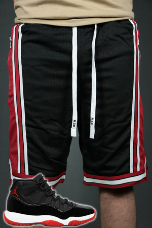The Chicago black red shorts to match Jordan 11 Bred sneakers by Jordan Craig.