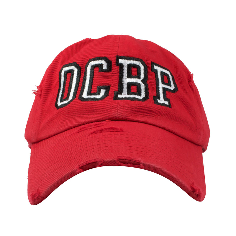 Embroidered on the front of the Ocean City Beach Patrol Red Distressed Dad Hat is the OCBP lettering in white and black