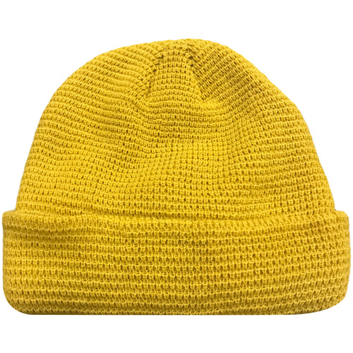 The golden yellow mustard waffle beanie features a waffle pattern and is solid golden yellow mustard