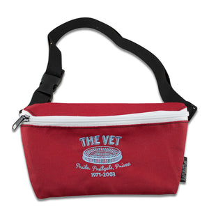 Embroidered on the front of the vet maroon fanny pack is the veterans stadium logo in light blue