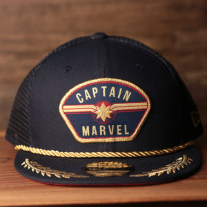 Captain Marvel Red Bottom Snapback | Captain Marvel Navy Trucker Red Bottom Snap Cap the front of this captain marvel snapback has the captain marvel logo on it with a navy blue crown