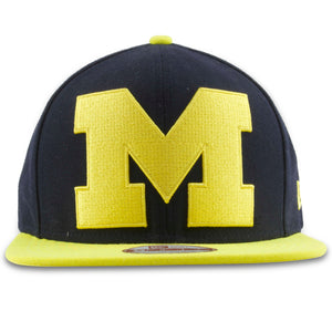 The Michigan XL logo snapback hat has a yellow Michigan logo embroidered on the front
