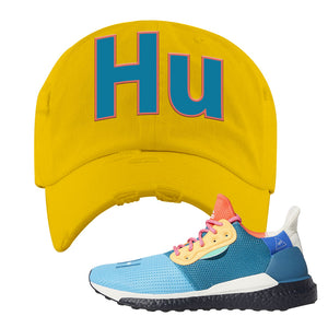 Foot Clan  Pharrel Williams X SolarHU Multicolor  HU  Yellow  Distressed Dad Hat    Rock your favorite pair of kicks in style with this Pharrel Williams X SolarHU Multicolor Sneaker Yellow Distressed Dad Hat. The HU logo on the front of this Pharrel Williams X SolarHU Multicolor Sneaker Yellow Distressed Dad Hat is what your sneaker matching outfit has been missing. Match your shoes today!