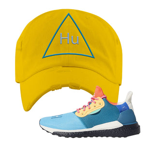 Foot Clan  Pharrel Williams X SolarHU Multicolor  HU Triangle  Yellow  Distressed Dad Hat    Rock your favorite pair of kicks in style with this Pharrel Williams X SolarHU Multicolor Sneaker Yellow Distressed Dad Hat. The HU Triangle logo on the front of this Pharrel Williams X SolarHU Multicolor Sneaker Yellow Distressed Dad Hat is what your sneaker matching outfit has been missing. Match your shoes today!