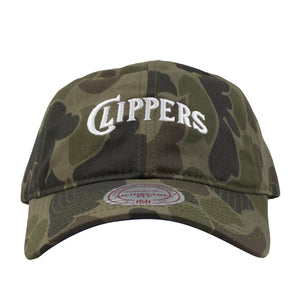Embroidered on the front of the Clippers woodland camouflage dad hat is the Clippers script in white