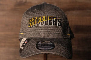 Steelers 2020 Training Camp Flexfit | Pittsburgh Steelers 2020 On-Field Grey Training Camp Stretch Fit  the front of this steelers cap is the steelers name