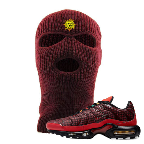 embroidered on the forehead of the air max plus sunburst sneaker matching maroon ski mask is the vintage lion head logo