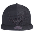 the chicago bulls retro air jordan 3 black cat sneaker matching snapback hat is two tone with the crown being half black and half jordan 3 black cat inspired pattern