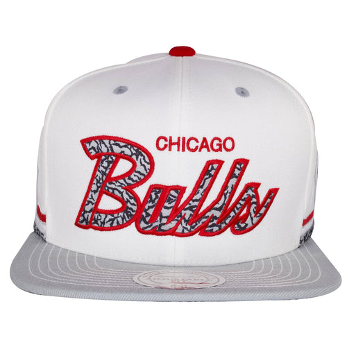 The front of this Chicago Bulls Katrina 3 Sneaker Snapback Hat shows the Chicago Bulls wordmark embroidered in gray, black, and red.