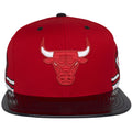 The flat bill of this Chicago Bulls red snapback is made with a black patent leather material, the same material used on the Air Jordan 11s shoes. The front of this Red Chicago Bulls Snapback Cap is the Bulls Logo heavily embroidered in red and white.