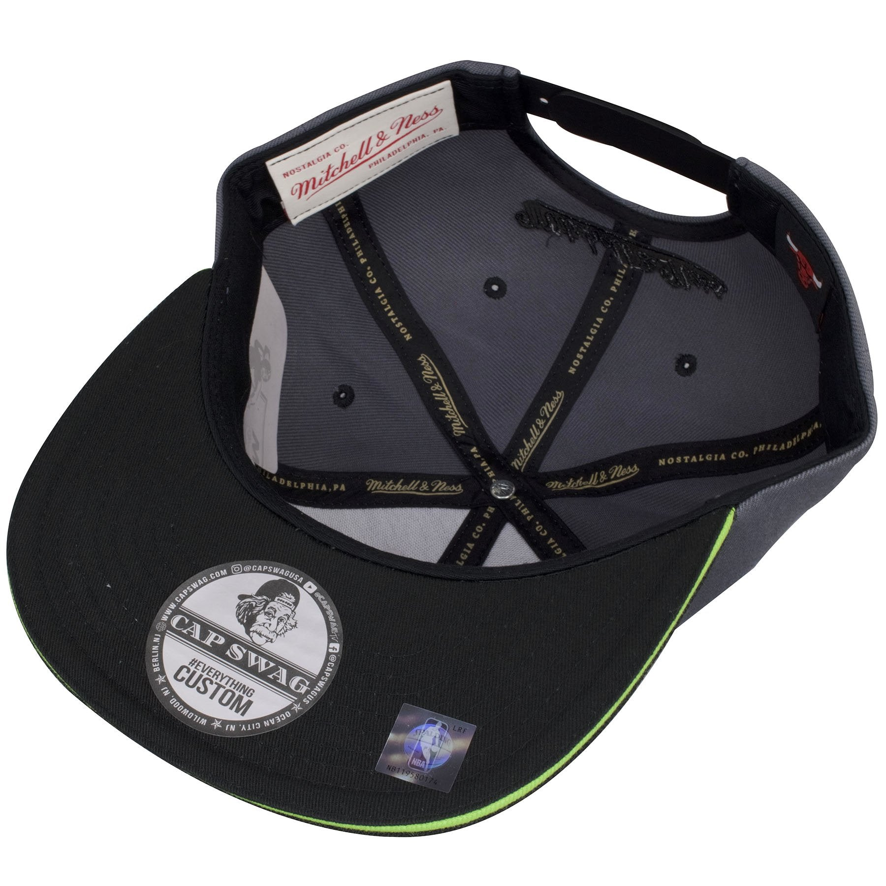 factory authentic 1b7df 618a9 ... Underneath this Mitchell and Ness Chicago Bulls Snapback cap shows a  black fabric bill.