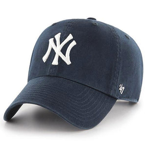 on the front of the classic new york yankees navy blue baseball cap is the yankees logo embroidered in white
