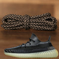 The black Yeezy 350 V2 reflective rope yeezy matching shoe laces alongside the Yeezy 350 V2 Zyon