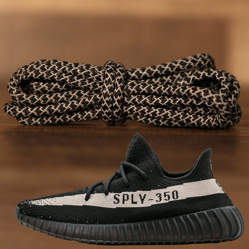 The black Yeezy 350 V2 reflective rope yeezy matching shoe laces alongside the Yeezy 350 V2 Oreo
