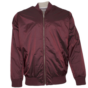 the reversible diamond supply co bomber jacket has a burgundy exterior and a cream interior